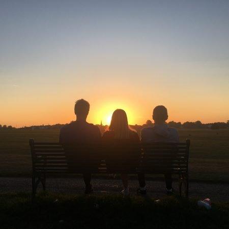 Image of 3 people watching a sunrise illustrating the Fairisle article New beginnings