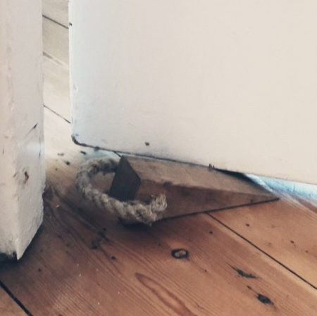 Image of a wooden wedge holding a door open illustrating the Fairisle article Value resistance to change