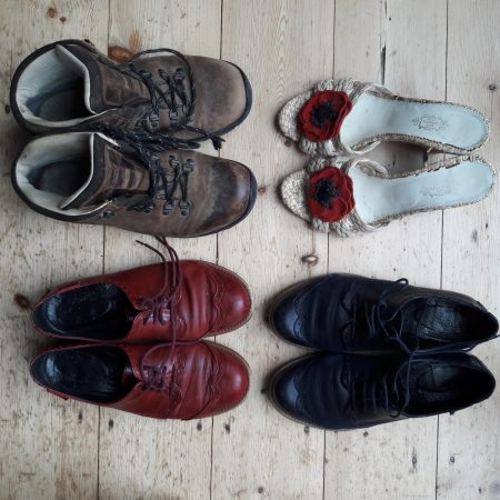 Image of empty pairs of shoes facing each other illustrating the Fairisle article Making progress resolving resistance